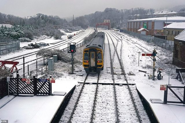 A train arrives at Hexham train station in Northumberland this morning as heavy snow and freezing rain batters the UK