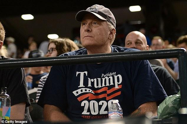 The president endorsed Schilling to run for Congress in August 2019. He is pictured watching the MLB game between the San Francisco Giants and Arizona Diamondbacks at Chase Field on August 3, 2018 in Phoenix, Arizona