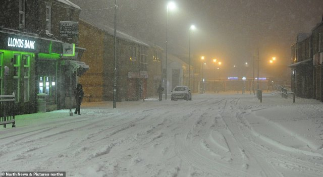 A vista of white snow covers a main road in the County Durham town of Consett today as flurries continue this morning