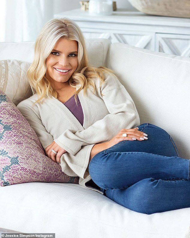 New glam look:Jessica Simpson looked like a blonde pinup in a new photo posted for her 5.6M Instagram followers on Thursday. The 40-year-old singer turned fashion designer wore a beige cardigan with skinny jeans as she flashed a radiant smile while cuddled up on her sofa inside her Hidden Hills, California home