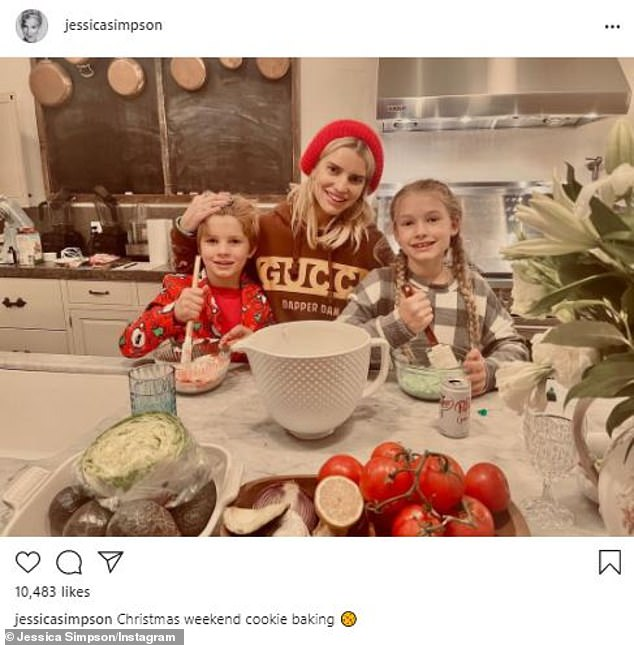She is a busy mom: With two of her three kids inside her kitchen where she is the family chef