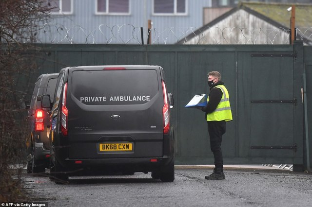 Undertakers vans queue to enter a temporary morgue in Aylesford, Kent, today which is another one that has been set up