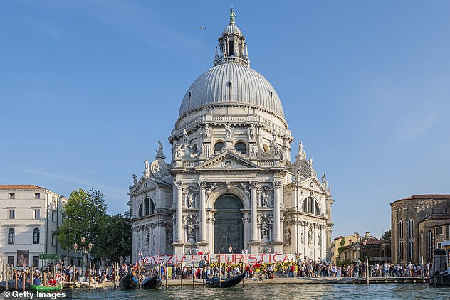 Protesters (pictured) also want to keep large ships outside Venice's lagoon and encourage permanent residents over tourism