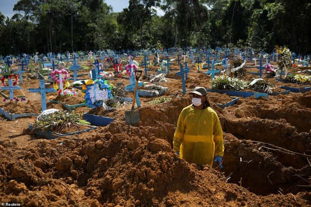 Manaus, where the new mutation detected in Japan is believed to have originated, has been placed in a state of emergency for six months as hospitalisations passed the levels seen in the worst days of last year. Pictured: A gravedigger works at Parque Taruma cemetary in Manaus