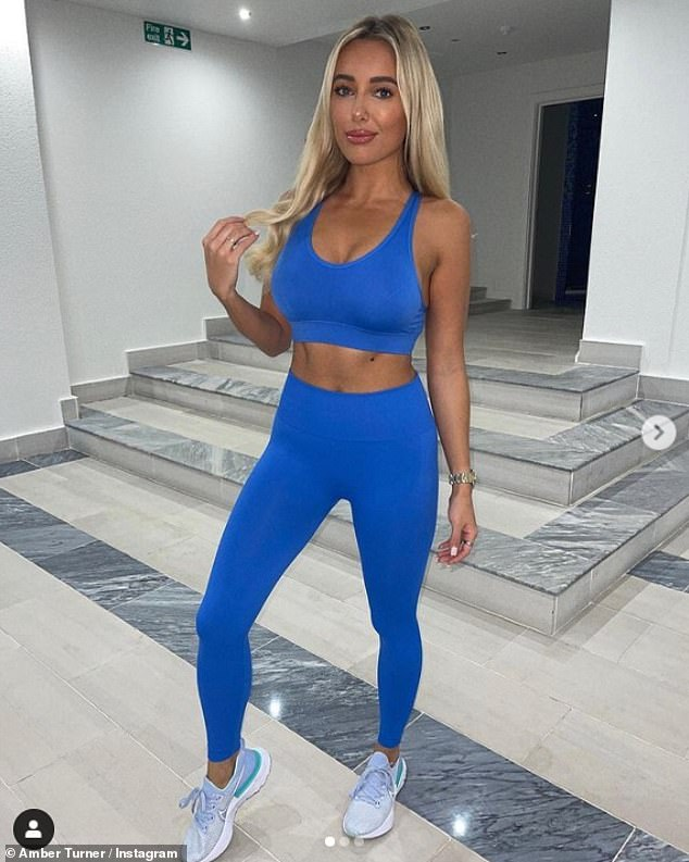 Stunning: Amber Turnershowcased her taut midriff and pert cleavage in her workout outfit on Thursday at her home in Chigwell, Essex