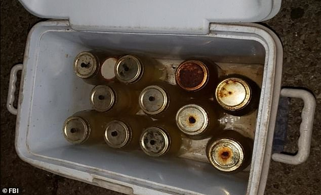 Lonnie Coffman, 70, was arrested after authorities say they found guns and 11 Molotov cocktail explosive devices (pictured) made out of Mason jars, golf tees and cloth rags in his pickup truck