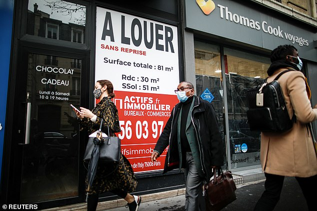 An estate agents' letting sign board stands in front of a vacant shop for rent in the city centre, amid the coronavirus disease (COVID-19) pandemic, in Paris, France January 14