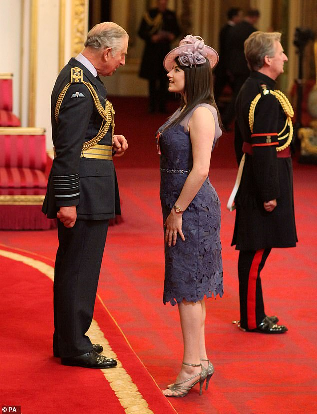 Royalty: Hollie receiving her MBE from the Prince Of Wales