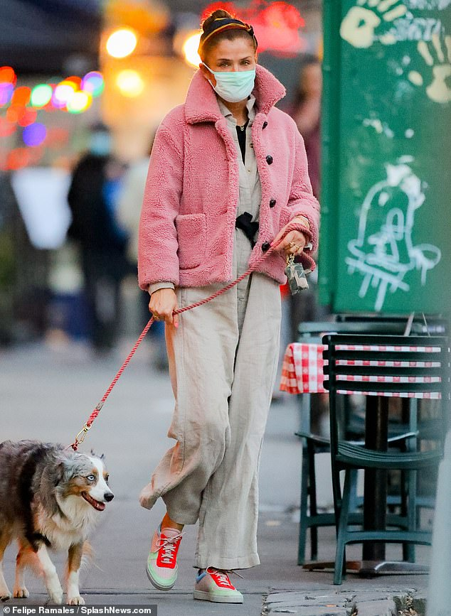 Pretty in pink: Helena Christensen, 52, added some color to her casual ensemble with a fuzzy pink jacket as she ran errands in NYC on Wednesday with her Australian Shepherd Kuma