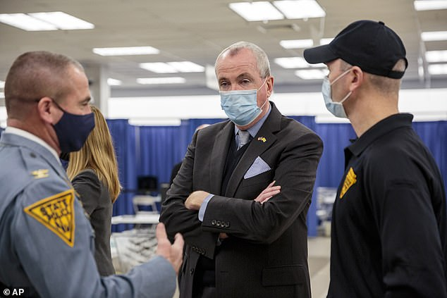 New Jersey Gov. Phil Murphy last week touring a COVID-19 vaccination site in Rockaway. As of Wednesday, smokers get access to the vaccine in NJ