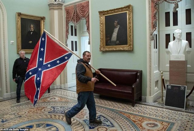 The FBI has identified the man carrying the Confederate flag into the United States Capitol during the MAGA mob riot on January 6 as Kevin Seefried of Laurel, Delaware. Seefriend was arrested on Thursday and charged with several misdemeanors, including trespassing and disorderly conduct