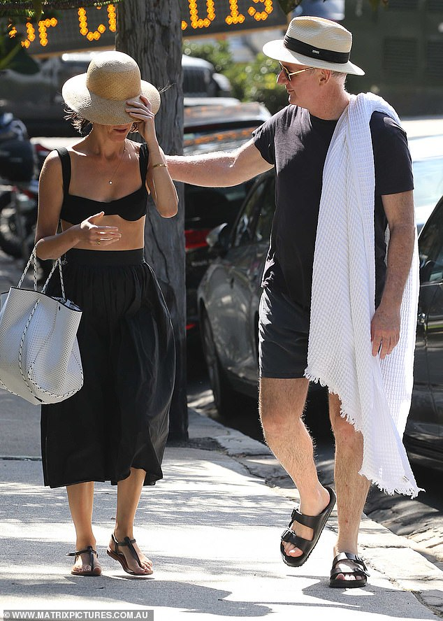 Marks, 54, wrapped his arm around Ms Baker, 38, as they strolled back from Camp Cove beach in Sydney's east on Thursday