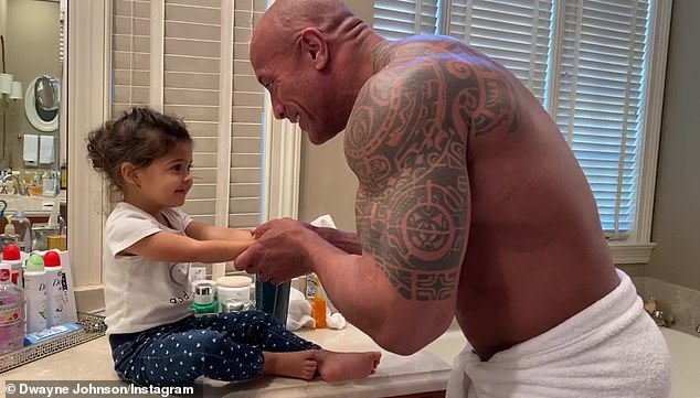 Daddy duty: He shared a short commercial for the new product set to tribal drums which showed the can featuring a logo reminiscent of Polynesian style tattoos much like The Rock has on his body as he is seen with his daughter Tia