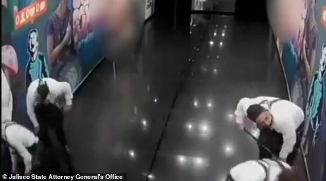 Restaurant employees in Puerto Vallarta, Mexico, are seen on a security video scrubbing the floor following the execution of former Jalisco governor Aristóteles Sandoval on December 18, 2020