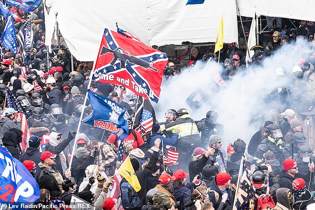 One group of rioters chanted: 'Hang Mike Pence!' as they stormed the Capitol. Pictured: Smoke from pepper-spray ball exploded and used against pro-Trump protesters during storm of the Capital building, January 6