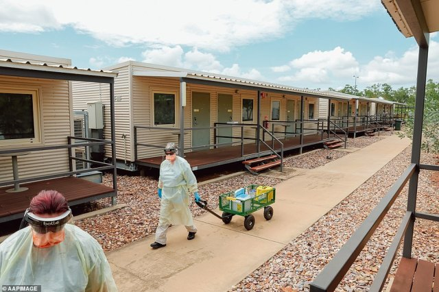 The workers camp on the outskirts of Darwin in the Northern Territory was re-purposed for quarantine in October and takes in 650 travellers a fortnight. Pictured: Workers deliver supplies to detainees