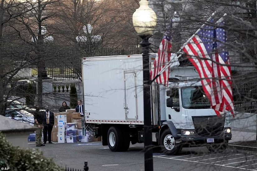 A van arrives to pick up boxes that were moved out of the Eisenhower Executive Office building at the White House Thursday
