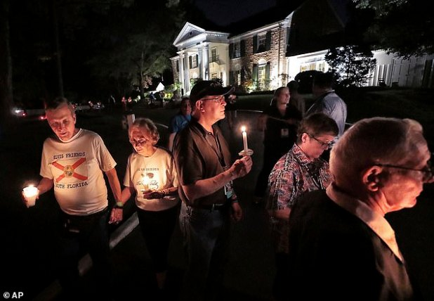 During the annual vigil, fans walk in and hold candles from Presley's tomb in Gresland.  This year, due to the epidemic, fans were asked to book a spot to allow for social distance