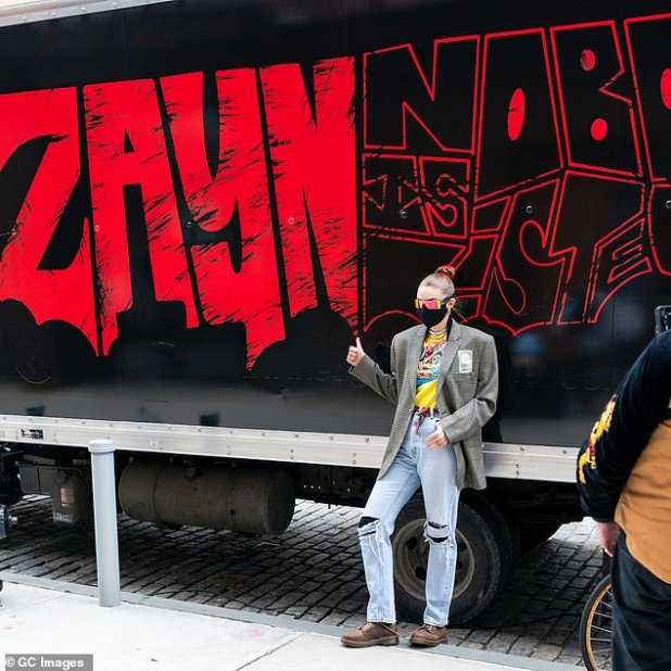 Sweet: Gigi then showed her support for Beur Zayn Malik's new album No One Listened To, presented with a promo truck
