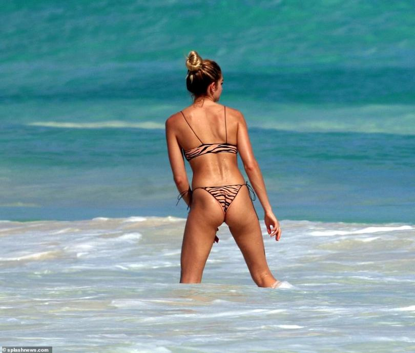 Wow factor: The 28-year-old chef wowed in a tiger print bikini as she frolicked in the water with her friends in the stunning locale of Tulum, Mexico on Thursday afternoon
