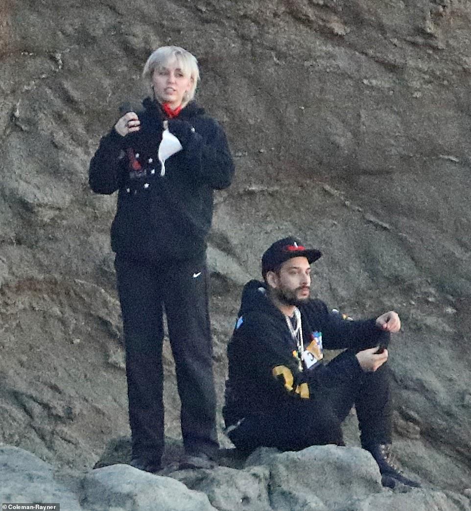 Miley Cyrus watches sunset in Malibu beach with stylist palBradley Kenneth McPeek