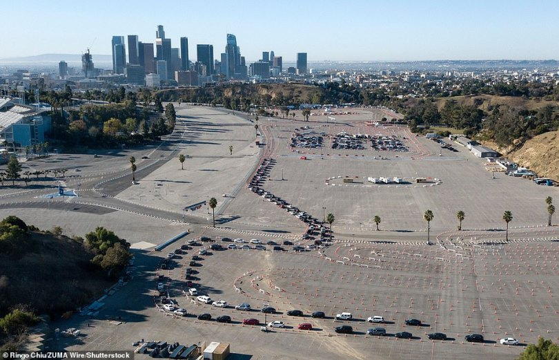 On Friday, the CDC reported that just 12 million doses have been administered to Americans across the country. However, cities such as Los Angeles are now opening large scale vaccination sites. Pictured: motorists lining up to receive their shot at Dodger Stadium
