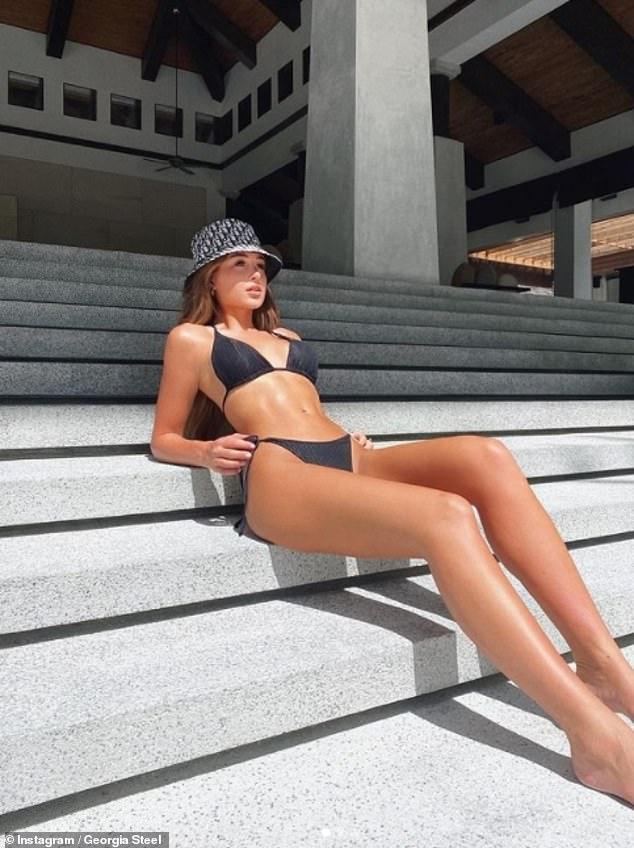 Love Island's Georgia Steel splays out across concrete steps in a skimpy bikini