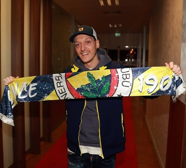 Mesut Ozil poses with a FenerHub dupatta after touching down in Istanbul on Sunday night