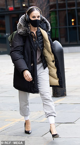 SJP had arrived for work earlier in the day bundled up in a quilted jacket with faux fur-trimmed hood