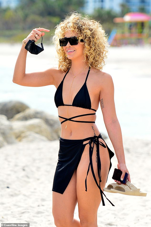 Accessories: She wore a delicate gold body chain which caught the light in the sunshine
