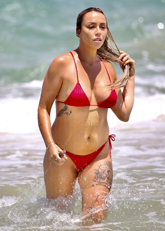 Red hot!! MAFS star Natasha Spencer had her very own Baywatch moment on Monday as she showed off her bombshell new look in a tiny string bikini during her Noosa getaway