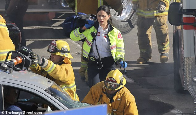 Lending a hand: The actress was seen rushing to the scene of a car accident, where she attempted to help out an actor portraying an injured person