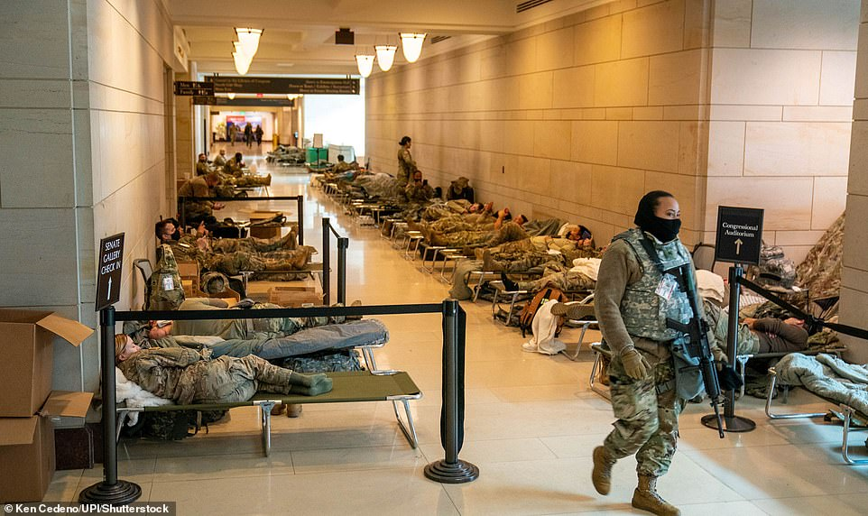 Troops with the National Guard are pictured sleeping in the Capitol on January 18