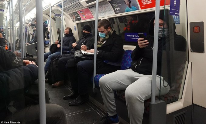 Commuters sit on a Jubilee Line train in East London this morning as England's third national lockdown continues