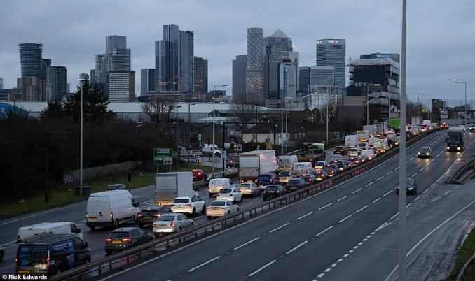 Heavy traffic on the Blackwall Tunnel southern approach road towards Canary Wharf in South East London today