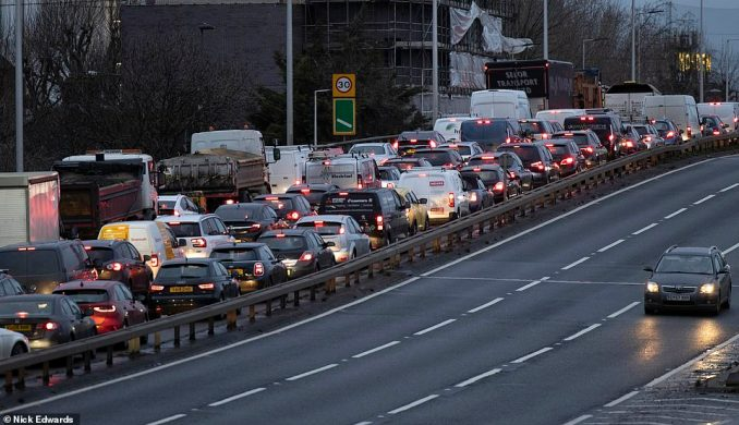 Vans, lorries and cars queue on the Blackwall Tunnel southern approach road in South East London this morning