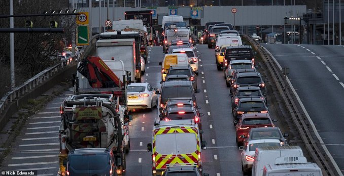 Traffic moves slowly on the Blackwall Tunnel southern approach road in South East London this morning