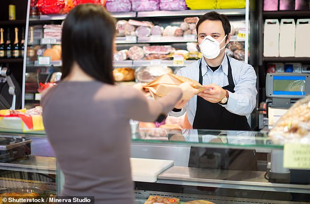 Condensation inside a face mask may help limit the amount of damage the coronavirus can do if a person gets infected, according to new research. The increased humidity in the air between a person's mouth and their mask is thought to assist the wearer's body to clear viral particles out of the airways (stock)