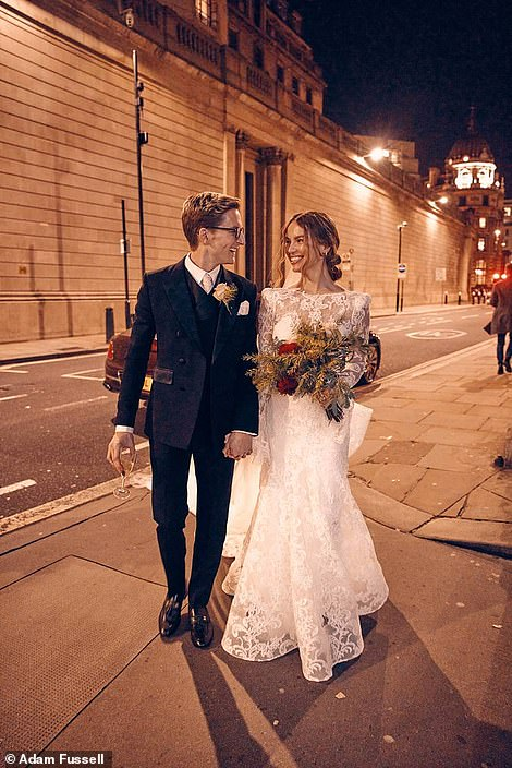 Out and about: Another snap showed them outside on the streets of London as Emma clutched a stunning winter bouquet