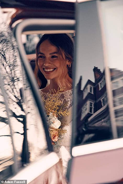 Beautiful bride: Emma looked radiant as she arrived at the church in a wedding car