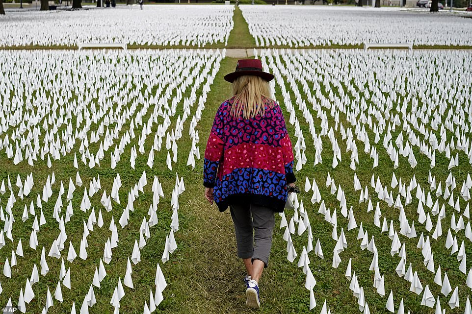 The first known deaths from the virus in the U.S. were in early February 2020, both of them in Santa Clara County, California. Pictured:Artist Suzanne Brennan Firstenberg walks among thousands of white flags planted in remembrance of Americans who have died of COVID-19 near Robert F. Kennedy Memorial Stadium in Washington, October 2020