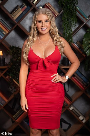 Dressed up: Ashley Irvine (left) looked very glamorous in a eye-popping red bodycon dress that showed off her ample cleavage