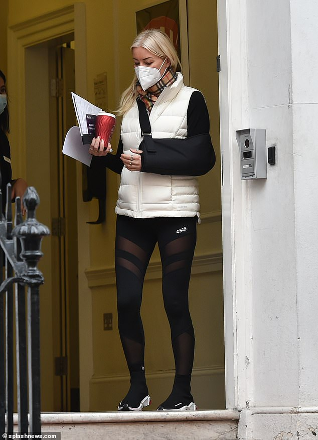Dancing On Ice's Denise Van Outen looks pained as she leaves doctors