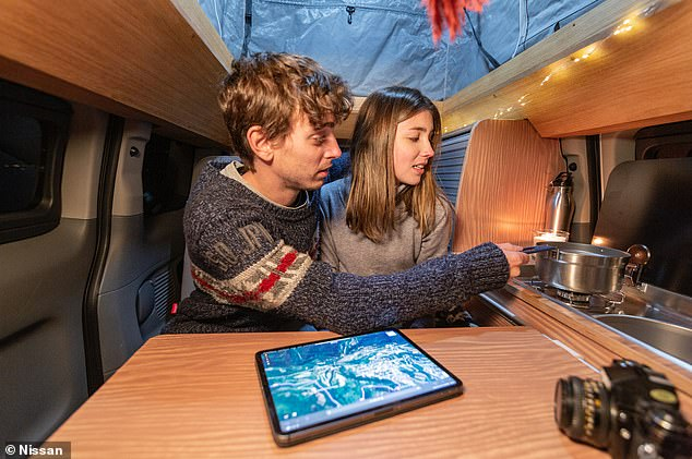 The camper has a fully-functioning kitchen, with a sink, hob and fridge
