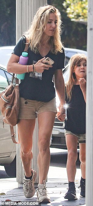Stunner: The Byron Bay resident, 44, looked effortlessly chic as she walked hand-in-hand with her little girl, wearing a casual black t-shirt and flashing beige shorts for the 'opportunity.