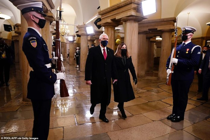 Pence, in his final moments as vice president, crosses the Capitol with his wife Karen as they arrive at the opening on Wednesday