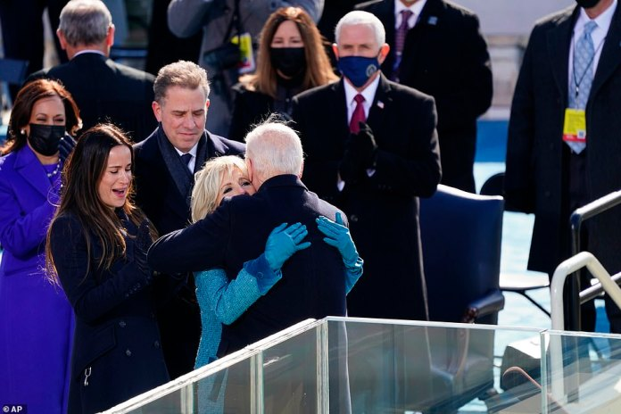 As Trump boycotted the ceremony, Pence applauded when Biden embraced his family after taking the oath of office as the 46th U.S. president.