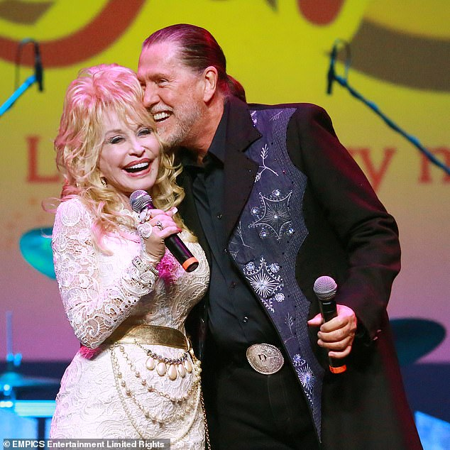 RIP: Dolly Parton announced brother Randy Parton had died of cancer in a Facebook post on Wednesday. The pair are seen in 2015 together above