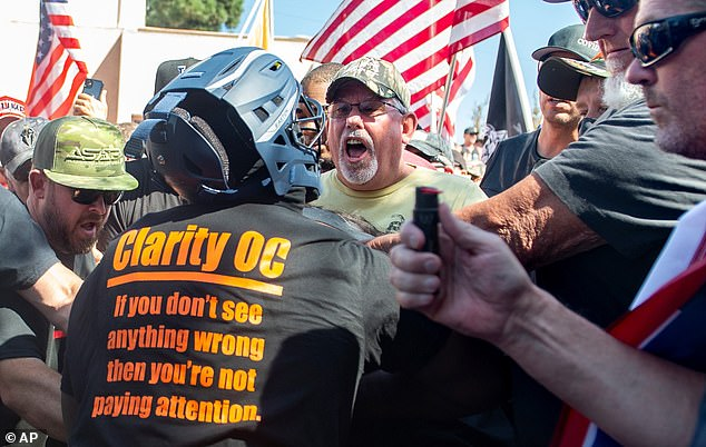 Authorities saidTurner deliberately drove into a crowd of Trump's supporters with the intent to kill a woman. Pictured: Black Lives Matter protesters and counter protesters clash in Yorba Linda, Calif., September 26