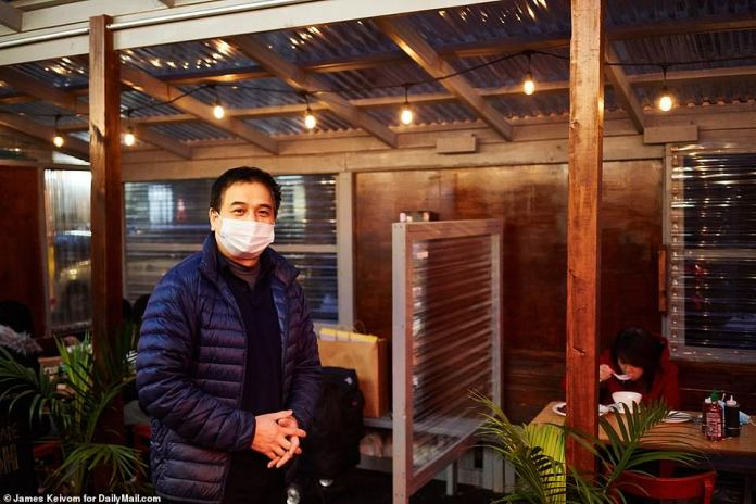 NEW YORK CITY:Andy Ha, owner and manager of Nha Trang One, said he desperately needs help from the government